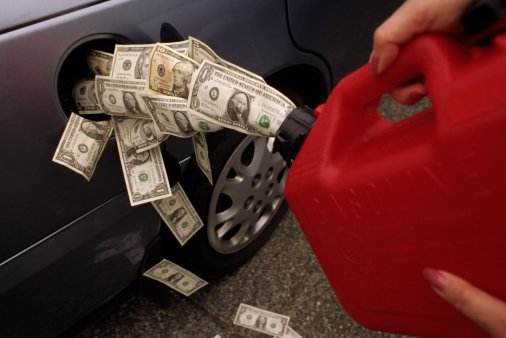 Woman pouring money from fuel container into car fuel tank, side view
