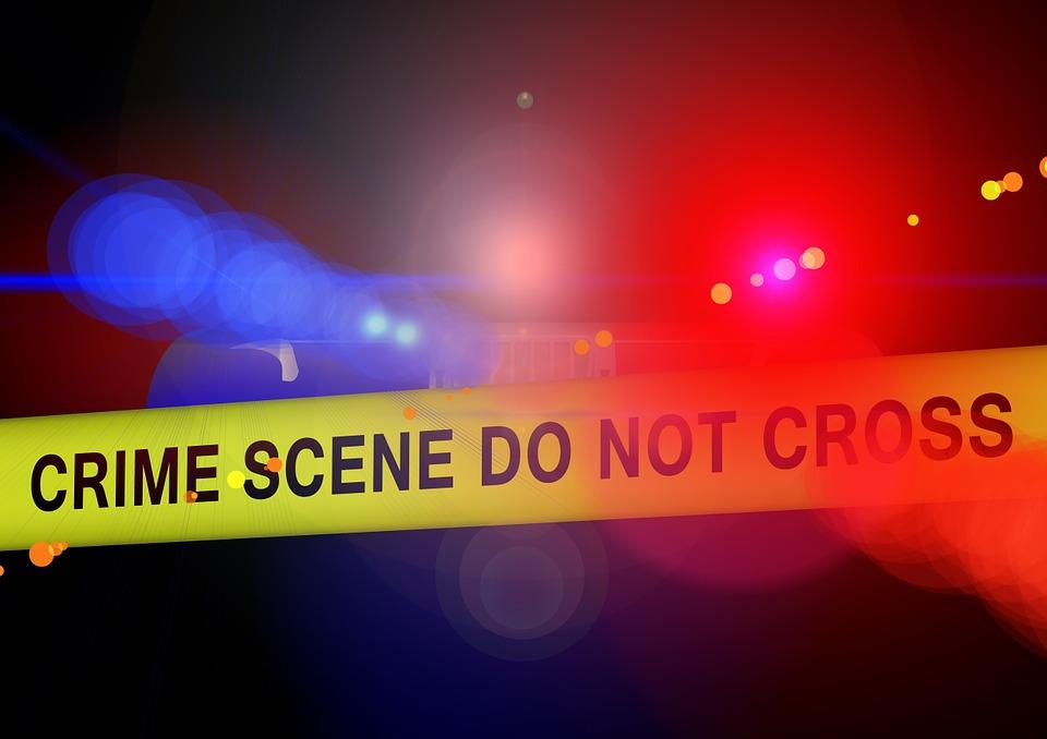 escena del crimen linea amarilla policia